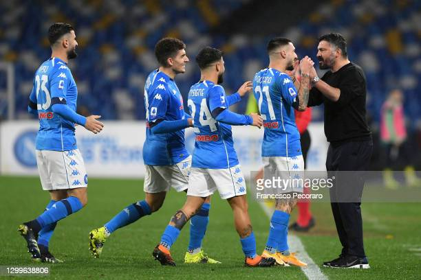 Matteo Politano of SSC Napoli celebrates with Gennaro Gattuso, head coach of Napoli and team mates after scoring their side's second goal during the...