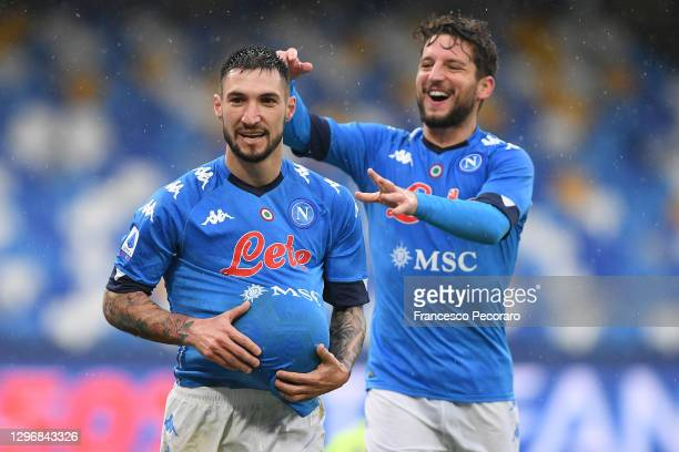Matteo Politano of S.S.C. Napoli celebrates with teammate Dries Mertens after scoring their team's sixth goal during the Serie A match between SSC...