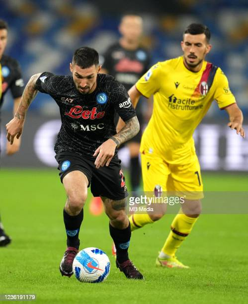 Matteo Politano of SSC Napoli competes for the ball with Nicola Sansone of Bologna FC ,during the Serie A match between SSC Napoli and Bologna FC at...
