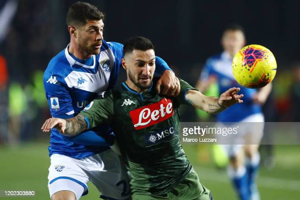 Matteo Politano of SSC Napoli competes for the ball with Stefano Sabelli of Brescia Calcio during the Serie A match between Brescia Calcio and SSC...