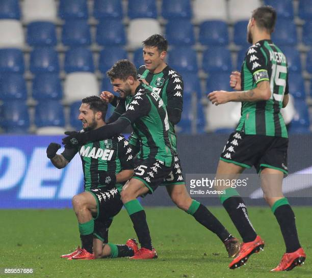 Matteo Politano of US Sassuolo Calcio celebrates his goal with his teammate Domenico Berardi and Federico Peluso during the Serie A match between US...