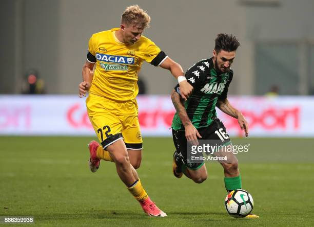 Matteo Politano of US Sassuolo Calcio competes for the ball with Antonin Barak of Udinese Calcio during the Serie A match between US Sassuolo and...