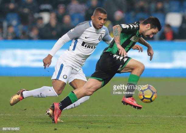 Matteo Politano of US Sassuolo Calcio is challenged by Henrique Dalbert of FC Internazionale Milano during the serie A match between US Sassuolo and...