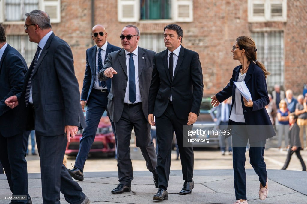 Matteo Renzi, Italy's former prime minister, second right, arrives for a memorial service for former Fiat Chrysler Automobiles NV chief executive officer Sergio Marchionne at the cathedral in Turin, Italy, on Friday, Sept. 14, 2018. Marchionne, the architect of the automaker's dramatic turnaround died, aged 66, on Wednesday, July 25, 2018. Photographer: Federico Bernini/Bloomberg via Getty Images