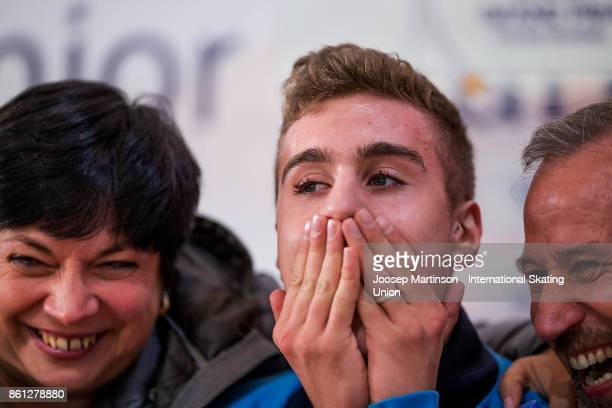 Matteo Rizzo of Italy reacts at the kiss and cry in the Junior Men's Free Skating during day three of the ISU Junior Grand Prix of Figure Skating at...