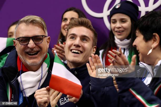 Matteo Rizzo of Italy reacts with teammates after competing in the Figure Skating Team Event Men's Single Skating Short Program during the...