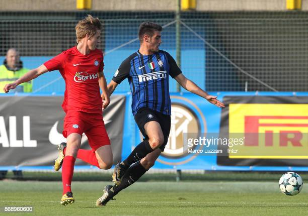 Matteo Rover of FC Internazionale is challenged during the UEFA Youth League Domestic Champions Path match between FC Internazionale and Esbjerg fB...