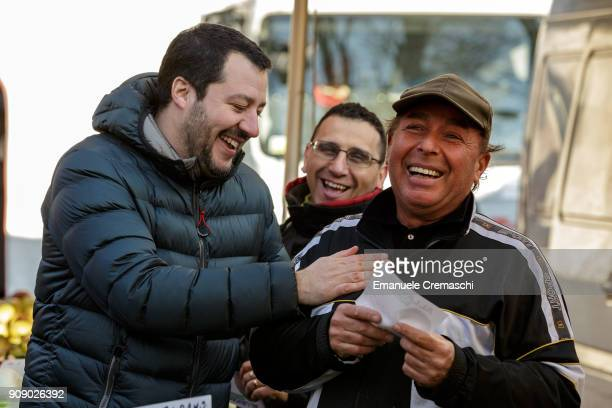 Matteo Salvini jokes with a street vendor as he visits an openair market on January 22 2018 in Milan Italy Salvini leader of the rightwing populist...