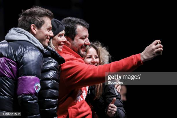 Matteo Salvini, leader of the League party, takes a selfie photograph supporters during a campaign rally in Maranello, Italy, on Saturday, Jan. 18,...