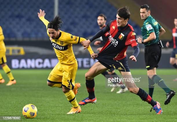 Matteo Scozzarella of Parma Calcio and Eldor Shomurodov of Genoa CFC during the Serie A match between Genoa CFC and Parma Calcio at Stadio Luigi...
