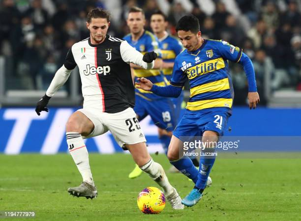 Matteo Scozzarella of Parma Calcio competes for the ball with Adrien Rabiot of Juventus FC during the Serie A match between Juventus and Parma Calcio...
