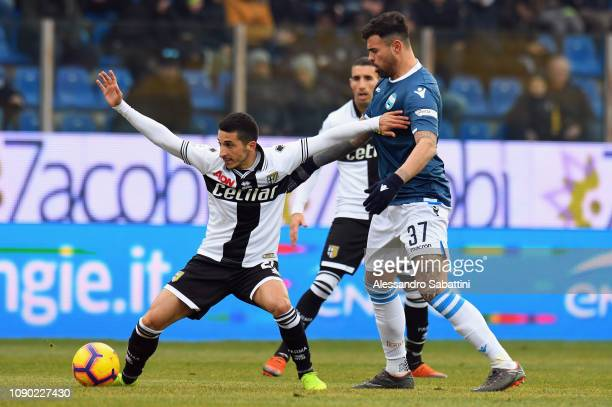 Matteo Scozzarella of Parma Calcio competes for the ball with Andrea Petagna of Spal during the Serie A match between Parma Calcio and SPAL at Stadio...