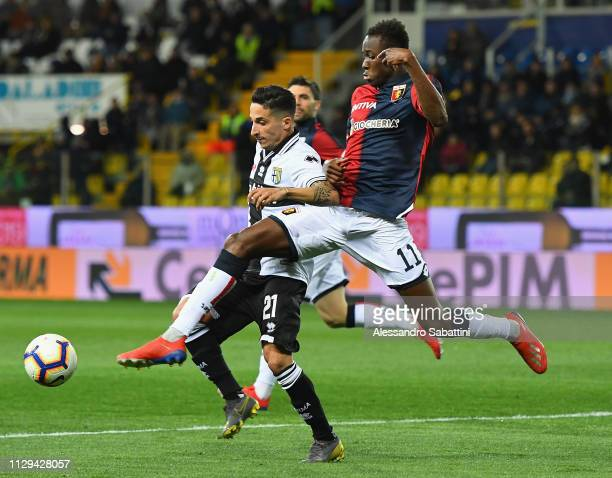 Matteo Scozzarella of Parma Calcio competes for the ball with Chritian Kouame of Genoa CFC during the Serie A match between Parma Calcio and Genoa...