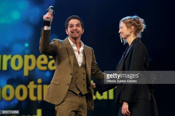Matteo Simoni accepts the award from Alba Rohrwacher on stage at the European Shooting Stars 2018 award ceremony and '3 Days in Quiberon' premiere...