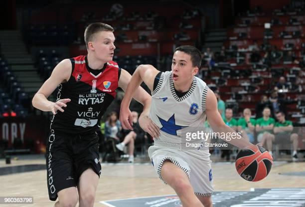 Matteo Spagnolo #6 of U18 Stellazzurra Rome Competes with Gediminas Mokseckas #1 of U18 Lietuvos Rytas Vilnius during the Adidas Next Generation...