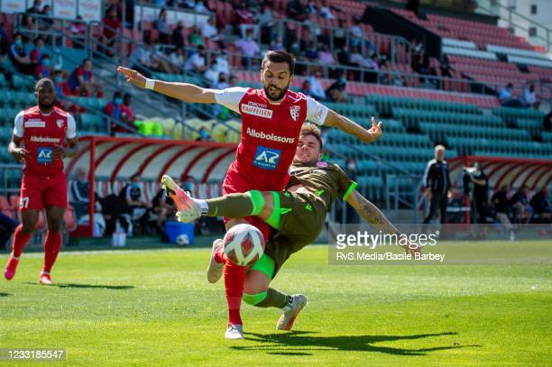 Matteo Tosetti of FC Sion battles for the ball with Dominik Schwizer of FC Thun during the Super League Barrage game between FC Sion and FC Thun at...