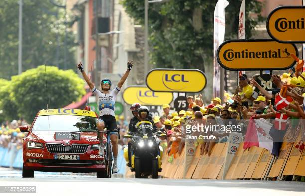Matteo Trentin of Italy and Mitchelton-Scott celebrates winning while crossing the finish line of stage 17 of the 106th Tour de France 2019, a stage...