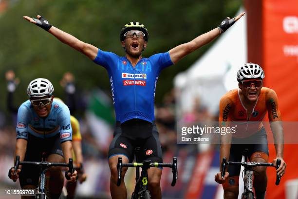 Matteo Trentin of Italy celebrates as he crosses the line and wins gold in the Men's Road Race during the road cycling on Day Eleven of the European...