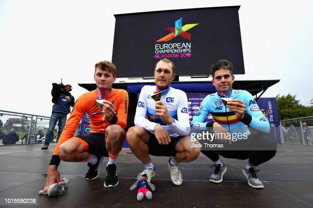 Matteo Trentin of Italy Mathieu Van Der Poel of Netherlands and Wout Van Aert of Belgium are presented with their medals for the Men's Road Race...