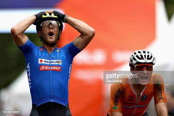 Matteo Trentin of Italy reacts as he crosses the line and wins gold ahead of Mathieu Van Der Poel of Netherlands in the Men's Road Race during the...