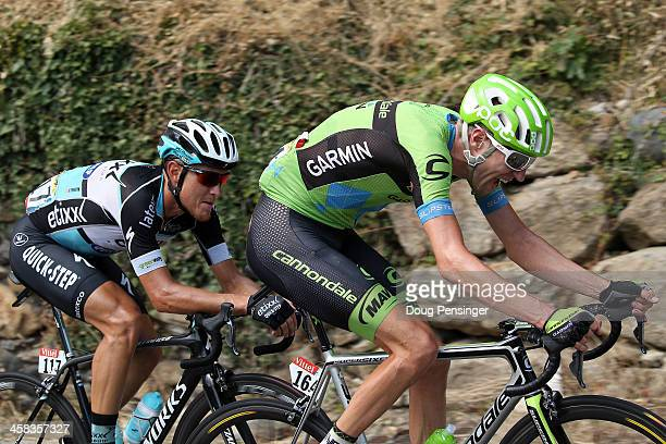 Matteo Trentin of Italy riding for Etixx-QuickStep and Ryder Hesjedal of Canada riding for Cannondale-Garmin are the last remaining riders of the...