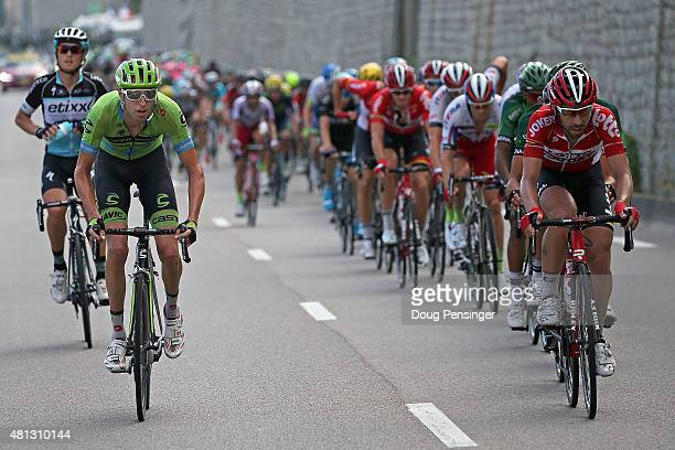 Matteo Trentin of Italy riding for Etixx-QuickStep and Ryder Hesjedal of Canada riding for Cannondale-Garmin are the last two riders of the breakaway...