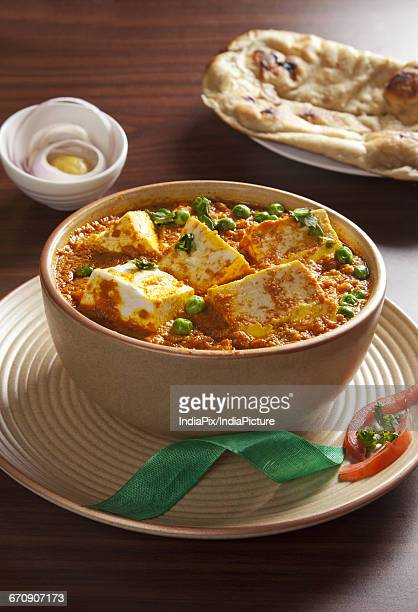 matter paneer in a bowl , indian food