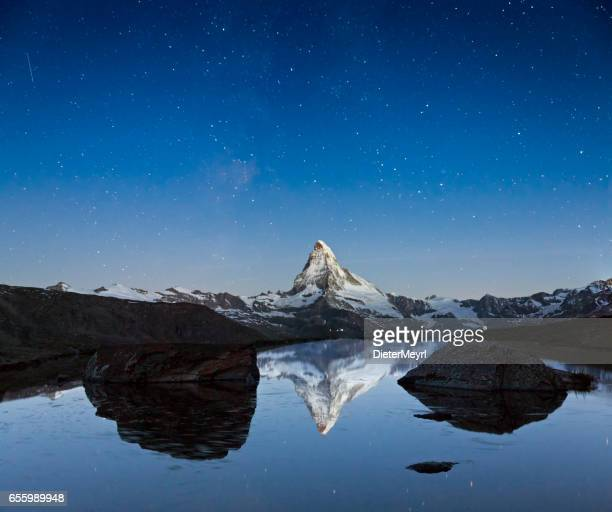 Matterhorn at stary sky with Stellisee in foreground