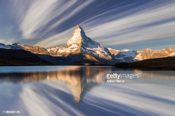 matterhorn at sunset reflected in stellisee lake in zermatt, switzerland. - idyllic stock pictures, royalty-free photos & images