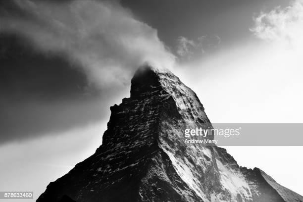 Matterhorn, close up of peak with cloud in black and white. Zermatt, Switzerland.