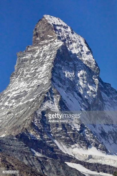 Matterhorn, close up of snow capped peak with blue sky, Zermatt, Switzerland.