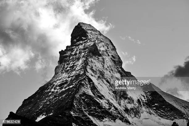 Matterhorn, close up of snow capped peak with cloud in black and white. Taken from Zermatt, Switzerland.