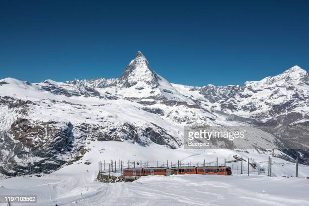 matterhorn in zermatt, switzerland. the mountain trains between zermatt and gornergrat in front of the matterhorn. swiss alps. - zermatt stock pictures, royalty-free photos & images