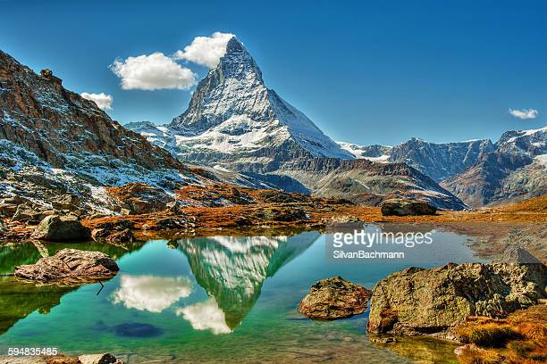 matterhorn mountain reflected in a lake, zermatt, switzerland - matterhorn stock pictures, royalty-free photos & images