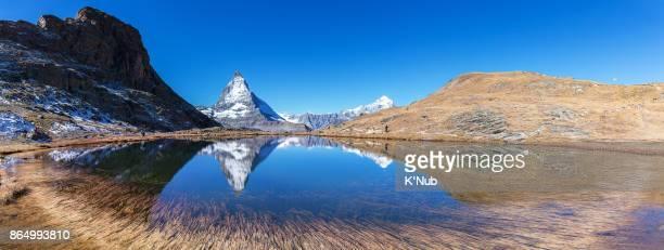Matterhorn mountain view from Riffelsee lake in summer at Zermatt Switzerland