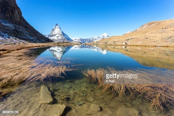 Matterhorn mountain view from Riffelsee lake on high mountain in Zermatt, Switzerland