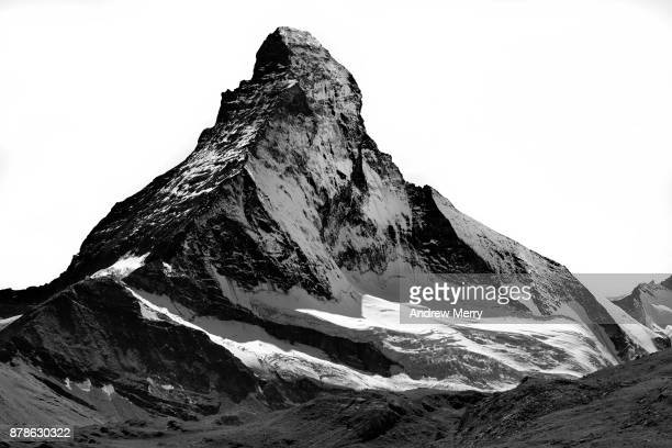 Matterhorn north face, snow capped, triangle shaped, high-contrast black and white.