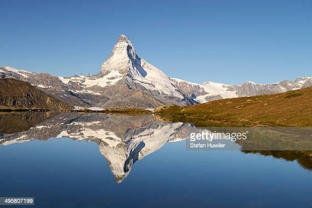 Matterhorn reflected in Lake Stellisee, Valais Alps, Canton of Valais, Switzerland