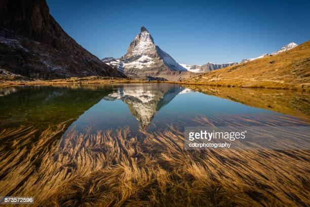 matterhorn reflected in mountain lake - zermatt stock pictures, royalty-free photos & images