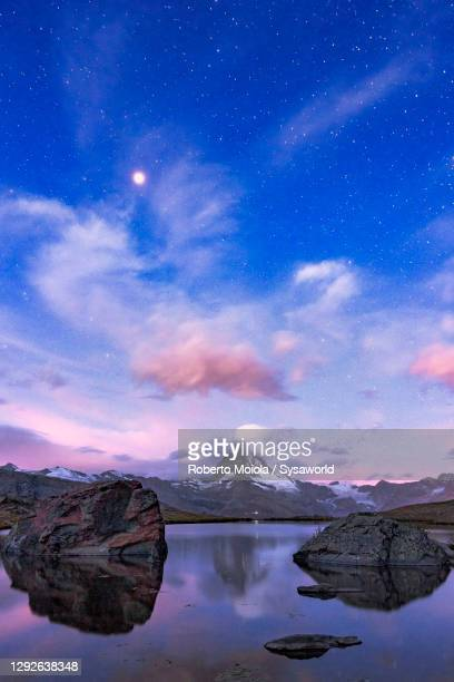 matterhorn reflected in stellisee lake at dusk, switzerland - star field stock pictures, royalty-free photos & images