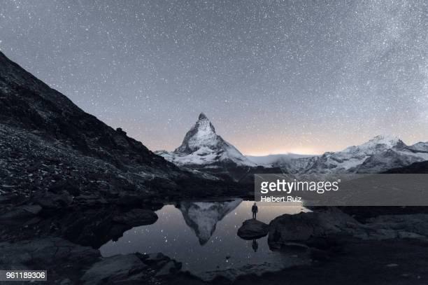 matterhorn reflecting over lake riffelsee at night, zermatt, valais, switzerland - matterhorn stock pictures, royalty-free photos & images