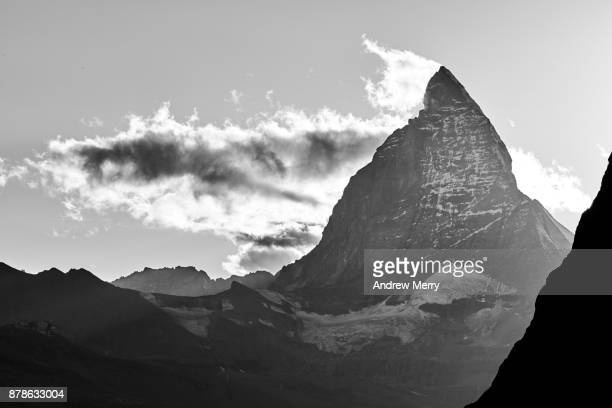 Matterhorn, triangle shaped with clouds in black and white, above Zermatt