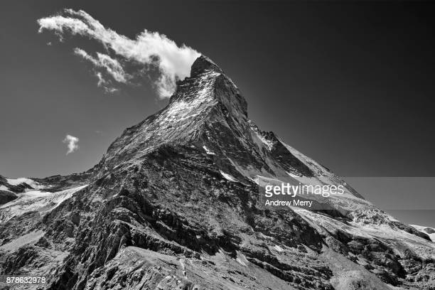 Matterhorn with cloud on summit in black and white, near the beginning of the technical climb to the Matterhorn summit
