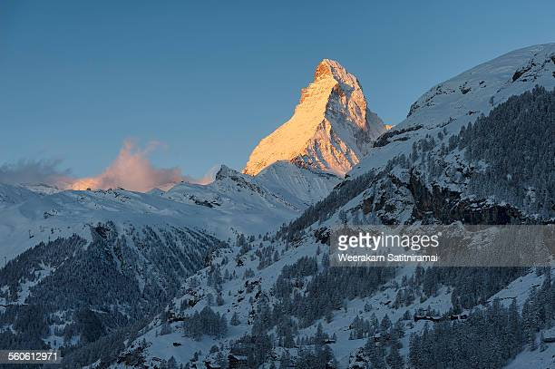 matterhorn with warming light in morning - pinnacle peak stock pictures, royalty-free photos & images