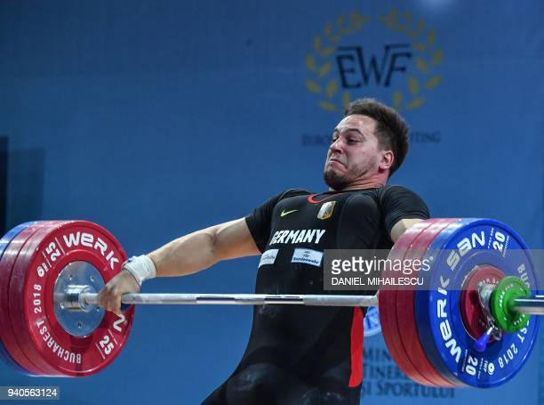 Matthaeus Hoffmann of Germany lifts during the men's senior 105 kg category of the European Weightlifting Championship in Izvorani, April 1, 2018. /...
