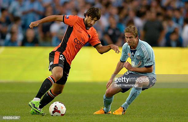 Matthew Acton of the Roar attempts to beat Matthew Thompson of Sydney during the round 12 ALeague match between Sydney FC and Brisbane Roar at...