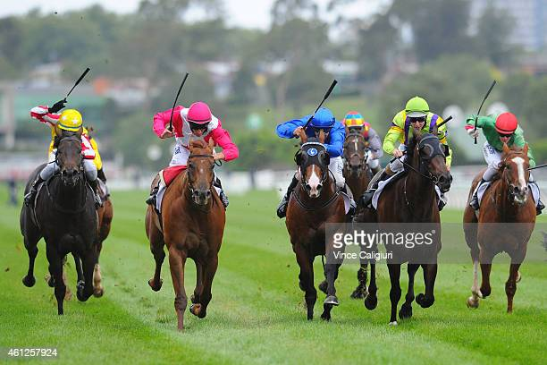 Matthew Allen riding The Quarterback defeats Regan Bayliss riding Sumakaray and Dwayne Dunn riding Orujo in Race 8 the Kensington Stakes during...