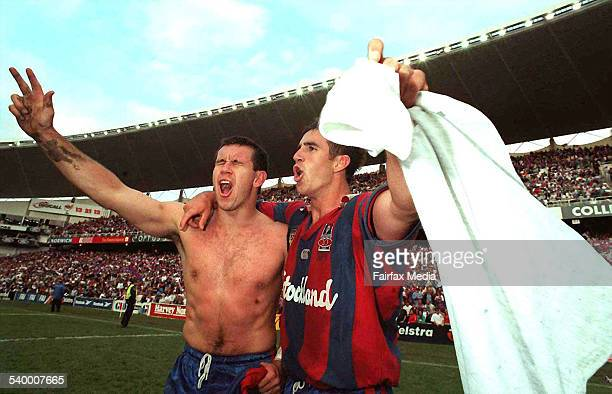 Matthew and Andrew Johns celebrate after the Newcastle Knights won the Grand Final 28 September 1997 NCH Picture by PETER STOOP