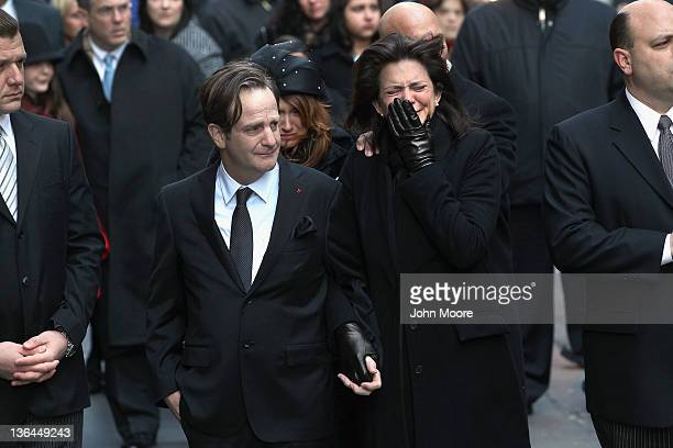 Matthew and Madonna Badger watch as the caskets carrying the bodies of their three daughters arrive for funeral services on January 5 2012 in New...