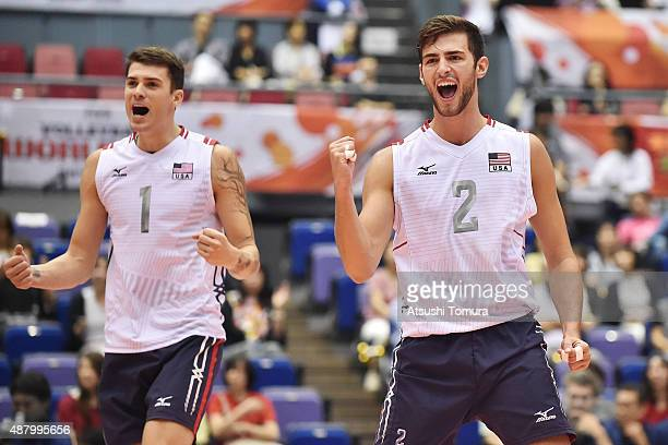 Matthew Anderson and Aaron Russell of the USA celebrate after winning a point in the match between Egypt and USA during the FIVB Men's Volleyball...